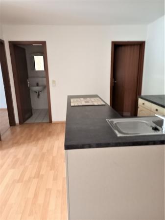 offene Küche, Blick zum Bad, SZ und Abstellk.